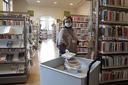 Coronavirus, biblioteca, mascherina
